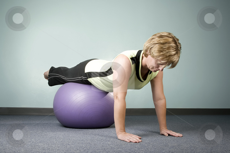 Woman Balancing on an Exercise Ball stock photo, Woman doing Workout Balancing on an Exercise Ball by Scott Griessel