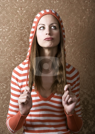 Young Woman Pulling on her Long Hair stock photo, Young Woman in a Hooded Sweater Pulling on the Ends of Her Hair by Scott Griessel