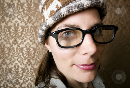 Nerdy Woman in a Knit Cap stock photo, Closeup of Cute Nerdy Woman in a Knit Cap by Scott Griessel