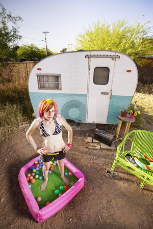 Woman outside a trailer stock photo, Woman standing in a play pool outside a trailer by Scott Griessel