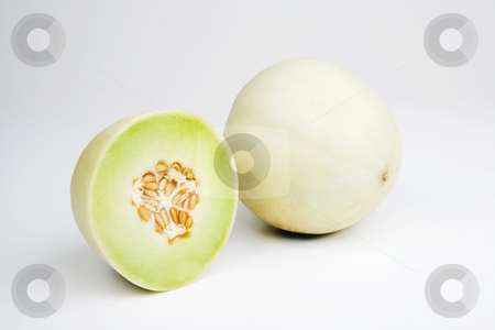 Honeydew Melon stock photo, Two halves of a honeydew melon on a white background by Scott Griessel