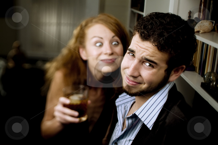 Woman Leers at Man at Party stock photo, Woman pursuing a man at a party makes him uncomfortable by Scott Griessel