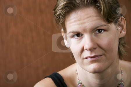 Pretty Woman stock photo, Attractive woman with a stern lokk on her face by Scott Griessel
