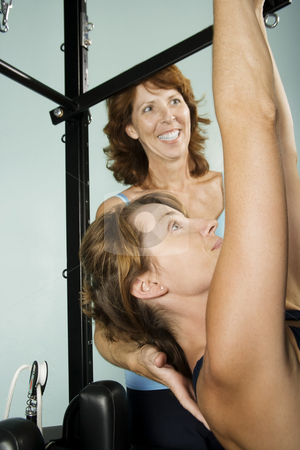 Woman Working Out With Personal Trainer stock photo, Athletic woman working out with a personal trainer by Scott Griessel