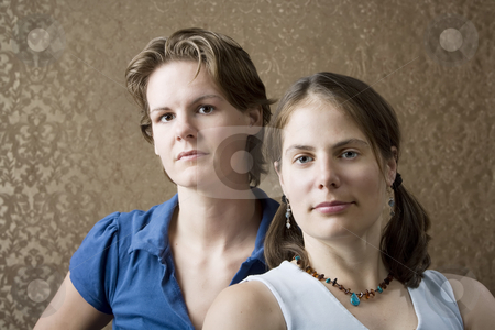Two Women in tee shirts stock photo, Portrait of Two Pretty Young Women Friends by Scott Griessel