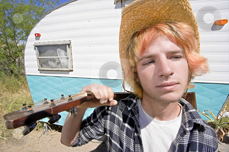 Young Man with a Guitar stock photo, Young Man with Bright Red Hair and a Guitar in front of Trailer by Scott Griessel