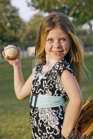 Cute young girl with a baseball stock photo, Cute young girl in summer dress with a baseball by Scott Griessel