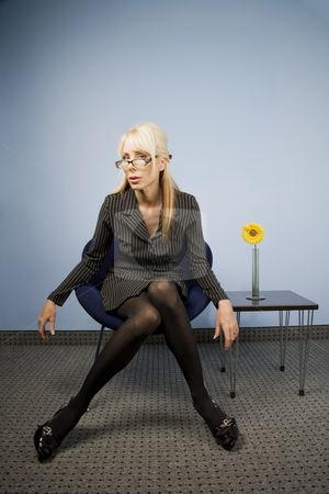 Businesswoman Akimbo stock photo, Businesswoman sitting in a casual akimbo fashion by Scott Griessel
