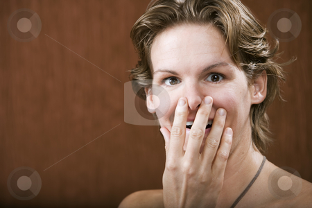 Surprised Woman stock photo, Portrait of a surprised woman in a studio setting by Scott Griessel
