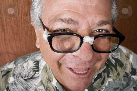 Silly Man with Taped Glasses stock photo, Silly Mexican-Italian Man with Taped Corrective Glasses by Scott Griessel