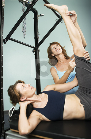 Personal Trainer stock photo, Athletic woman working out with a personal trainer by Scott Griessel