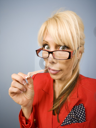 Woman in red with gum making a funny face stock photo, Woman in red pulling gum out of her mouth by Scott Griessel