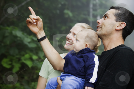 Mixed Hispanic Family with Cute Baby Boy in the Rain Forest stock photo, Mixed Hispanic Family with Cute Baby Boy Experienicing Nature in the Rain Forest by Scott Griessel