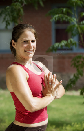 Yoga close up stock photo, Pretty Young Woman doing Yoga on a Porch Looking Towards the Camera by Scott Griessel