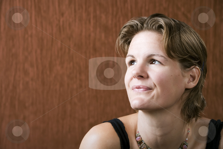 Woman Looking Up stock photo, Woman wering a necklace looking up to the left by Scott Griessel