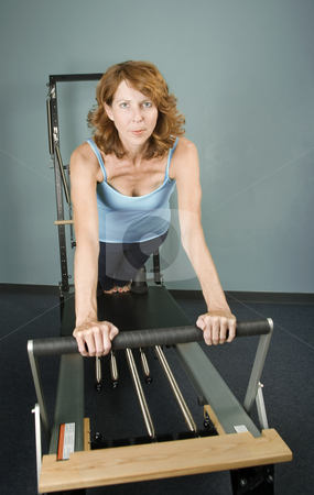 Pilates Workout stock photo, Pretty Woman Working Out on Pilates Equipment by Scott Griessel
