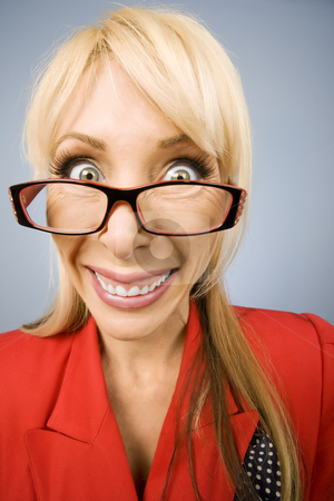 Happy woman in red with a big smile stock photo, Happy woman wearing glasses in red with a big smile by Scott Griessel