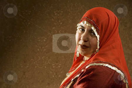 Muslim Woman stock photo, Portrait of a Muslim Woman in a Red Head Scarf by Scott Griessel