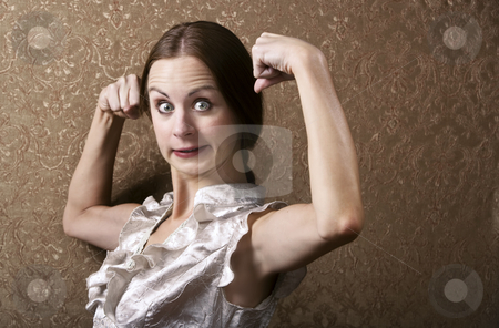 Young Woman Flexing Her Biceps stock photo, Pretty Young Woman Posing with Flexed Biceps by Scott Griessel