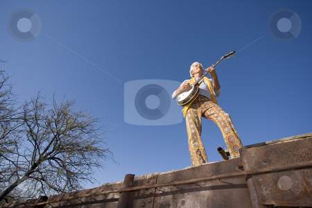Banjo Player stock photo, Wide angle shot of a banjo player against the blue sky by Scott Griessel