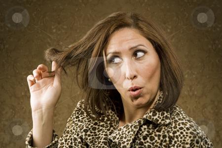 Hispanic Woman Twists her Hair stock photo, Hispanic Woman in Leopard Print Coat with Big Hair by Scott Griessel