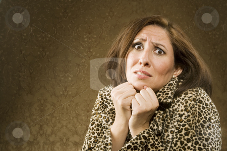 Fearful Hispanic Woman stock photo, Frightened Hispanic Woman in Leopard Print Coat by Scott Griessel