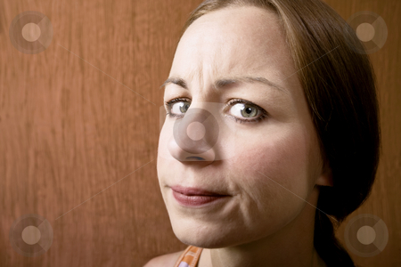 Woman with a Suspicious Look stock photo, Woman with a Suspicious Look on Her Face by Scott Griessel
