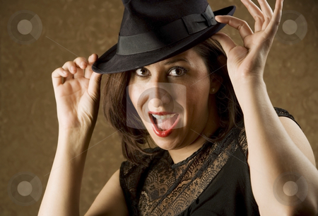 Hispanic Woman Tipping Her Hat stock photo, Pretty Hispanic Woman Tipping Her Fedora Hat by Scott Griessel