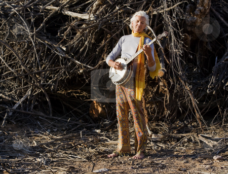 Barefoot Banjo Player stock photo, Barefoot banjo Player in Fraont of a Big Pile of Wood by Scott Griessel
