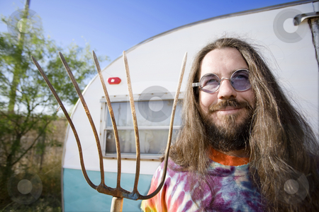 Man with a Pitchfork stock photo, Friendly Hippie with Long Hair and a Pitchfork by Scott Griessel