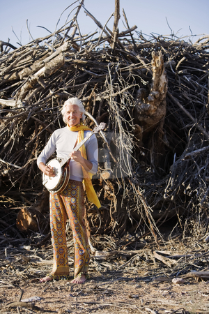 Barefoot Banjo Player stock photo, Barefoot banjo Player in Front of a Big Pile of Wood by Scott Griessel