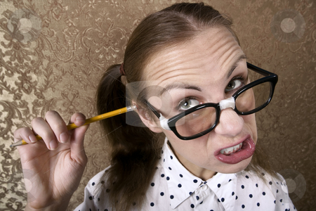 Nerdy Girl stock photo, Wide Angle Portrait of Nervous Nerdy Girl Cleaning Her Ear with a Pencil by Scott Griessel