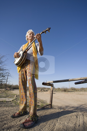 Banjo Player stock photo, Banjo player standing against the blue sky by Scott Griessel