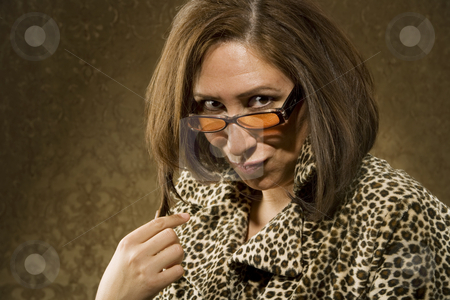 Hispanic Woman with Sunglasses Twists her Hair stock photo, Hispanic Woman in Leopard Print Coat with Big Hair and Sunglasses by Scott Griessel