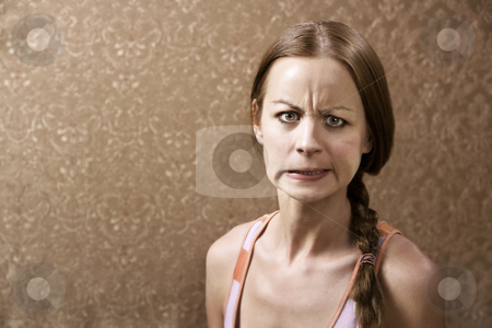 Angry Woman stock photo, Angry Young Woman in front of Gold wallpaper by Scott Griessel