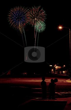 Urban Fireworks stock photo, Long exposure of fireworks over an urban street scene by Scott Griessel