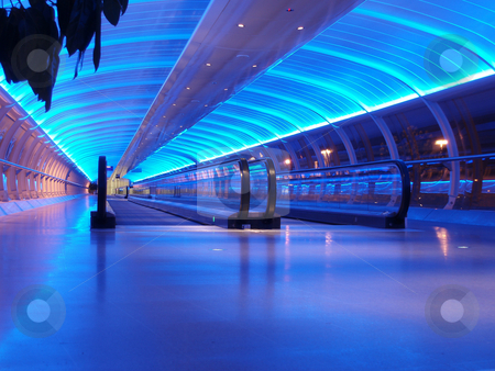 Airport walkway stock photo, Airport walkway tunnel with blue lights, manchester airport by Stephen Gibson