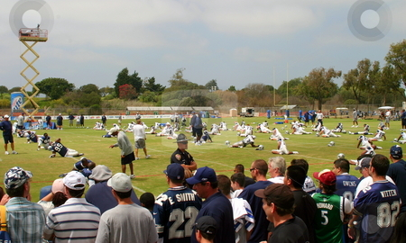 Texas Cowboys Training stock photo, The Dallas Cowboys at their 2008 summer training camp in Oxnard, CA during a training session working out. by Henrik Lehnerer