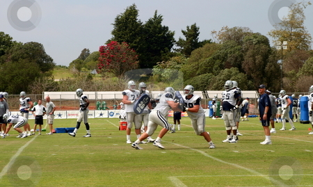 Dallas Cowboys Training stock photo, The Dallas Cowboys at their 2008 summer training camp in Oxnard, CA during a training session working out. by Henrik Lehnerer