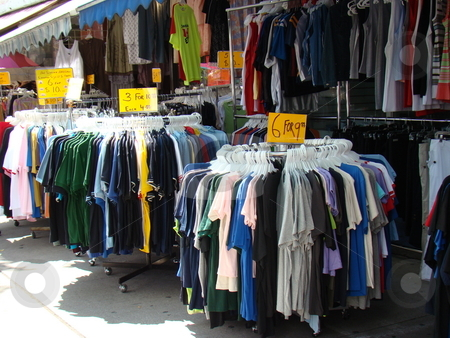 Clothes in a street market stock photo, Clothes in a street market by CHERYL LAFOND