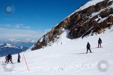 Skiers in Swiss Alps stock photo, Skiers in Swiss Alps mountain snow, winter scene. by Martin Crowdy