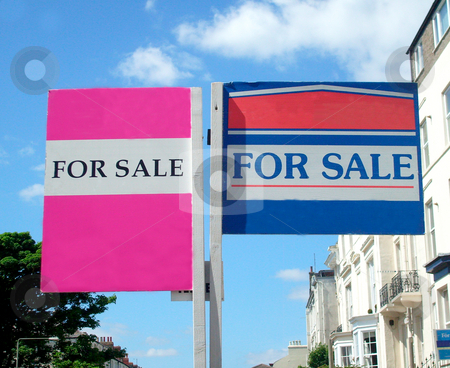 Houses for sale signs stock photo, Two houses for sale signs in English street. by Martin Crowdy