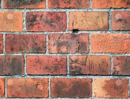 Red bricks in wall stock photo, Detail of some red bricks in wall. by Martin Crowdy