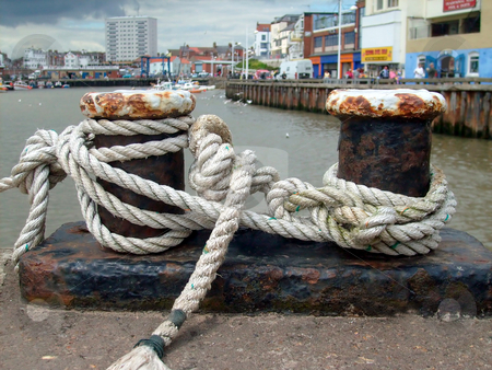 Knots in harbor stock photo, Close up of some sailors knots on quayside in Bridlington Harbor, England. by Martin Crowdy