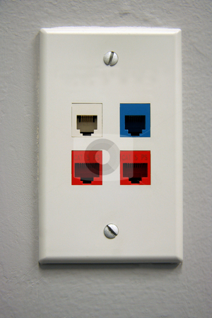 Telephone Outlet stock photo, A white telephone data outlet with 4 plugs for US data by Kevin Tietz