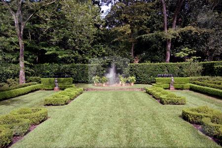 Garden Fountain stock photo, An english garden with a fountain spraying in the center by Kevin Tietz