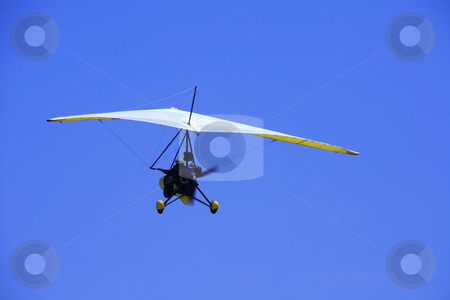 Ultralight aircraft 2 stock photo, Ultralight aircraft in flight against the blue sky by Jonas Marcos San Luis
