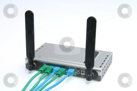 Wireless modem  stock photo, Wireless modem and router with four cables by Jonas Marcos San Luis