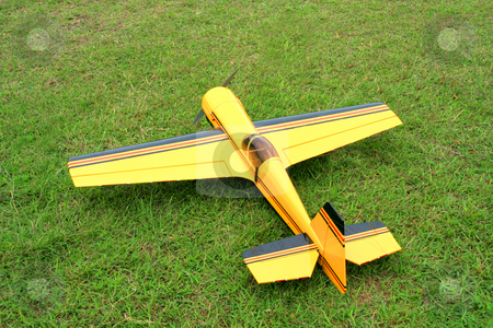 Rc airplane stock photo, Remote controlled toy airplane parked on the grass by Jonas Marcos San Luis