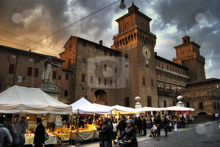 Market by the Castle stock photo, Outside Ferrara castle on market day. by James Rose